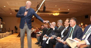Mark Eaton hands mic to audience member