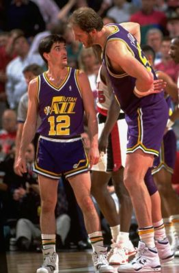 Mark and John Stockton have a discussion mid-game.